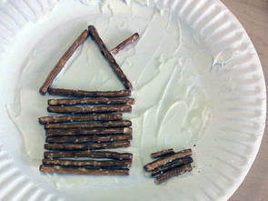 Log cabin made out of pretzel sticks